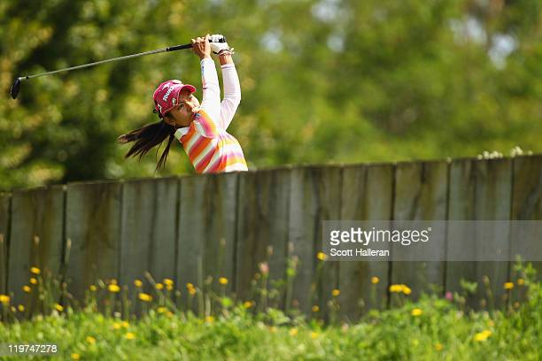 Ai Miyazato of Japan hits her tee shot on the 14th hole during the final round of the Evian Masters at the Evian Masters Golf Club on July 24 2011 in...