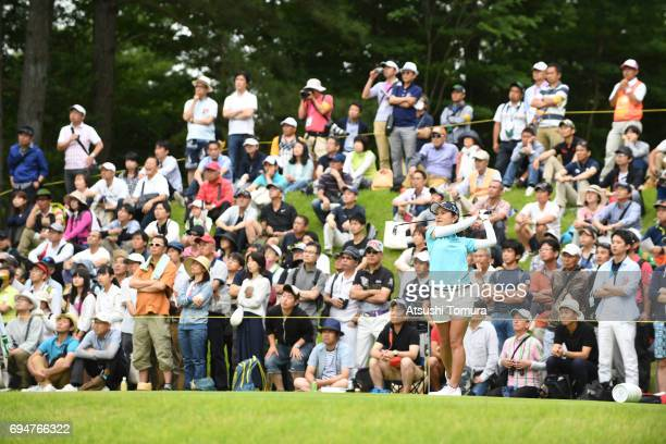 Ai Miyazato of Japan hits her tee shot on the 5th hole during the final round of the Suntory Ladies Open at the Rokko Kokusai Golf Club on June 11...