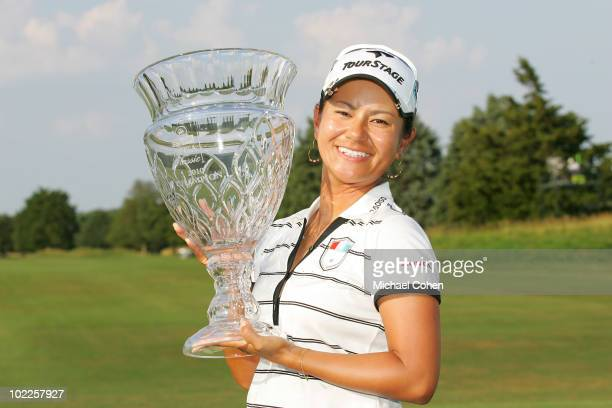 Ai Miyazato of Japan holds the trophy after winning the ShopRite LPGA Classic held at Dolce Seaview Resort on June 20 2010 in Galloway New Jersey
