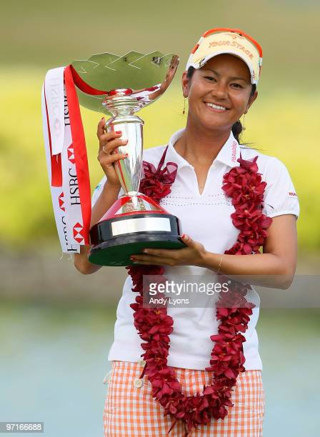 Ai Miyazato of Japan holds the winner's trophy after winning the HSBC Women's Champions at Tanah Merah Country Club on February 28 2010 in Singapore...
