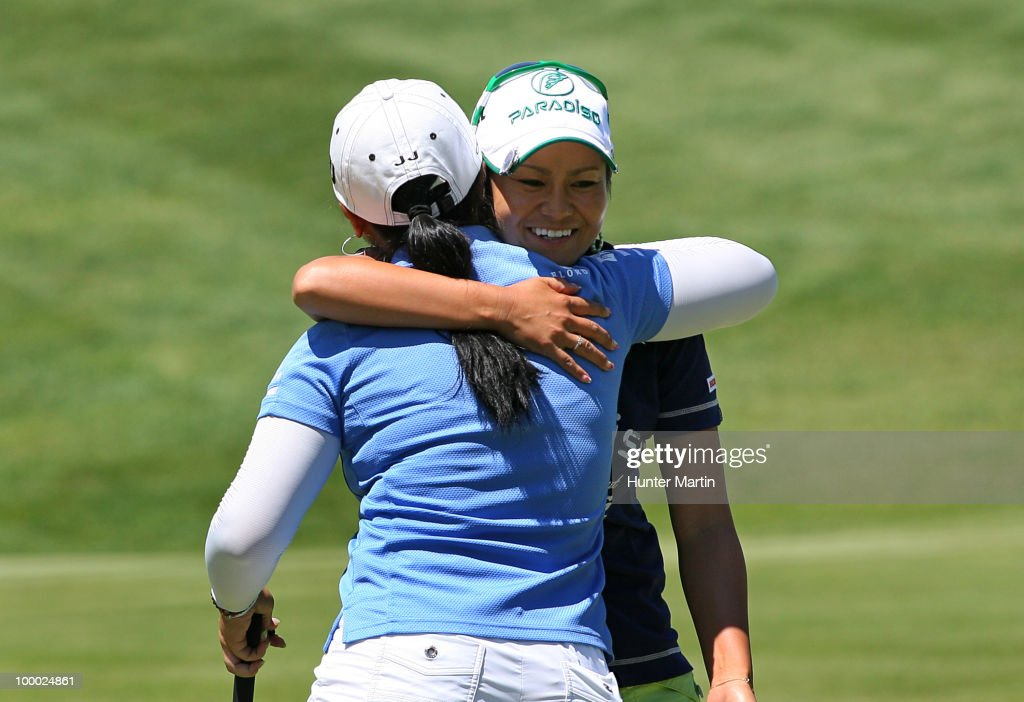 Ai Miyazato of Japan hugs Jeong Jang of South Korea after finishing their match on the 15th hole during the first round of the Sybase Match Play Championship at Hamilton Farm Golf Club on May 20, 2010 in Gladstone, New Jersey.