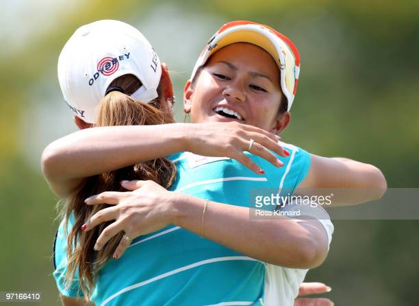 Ai Miyazato of Japan is congratulated by Momoko Ueda of Japan after the final round of the HSBC Women's Champions at the Tanah Merah Country Club on...