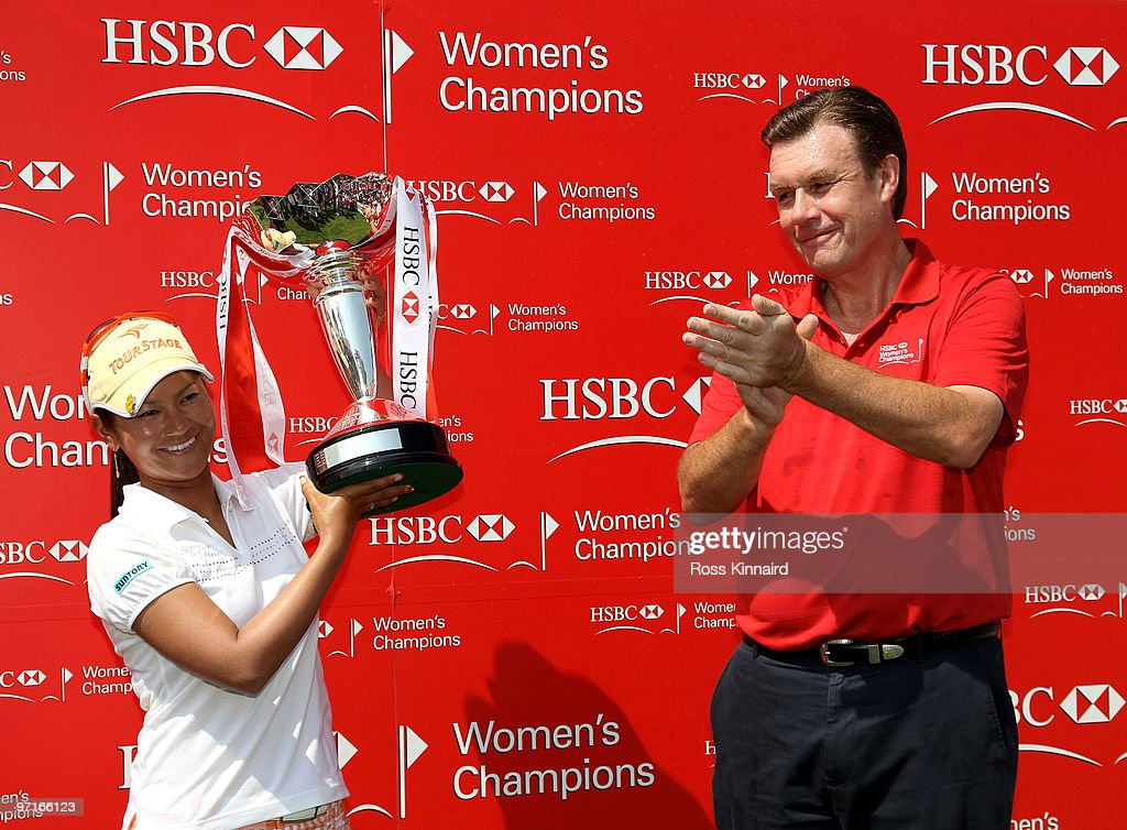 Ai Miyazato of Japan is presented with the winners trophy by