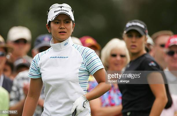 Ai Miyazato of Japan is seen after making a tee shot on the 16th tee as Natalie Gulbis looks on during the first round of the LPGA Kraft Nabisco...