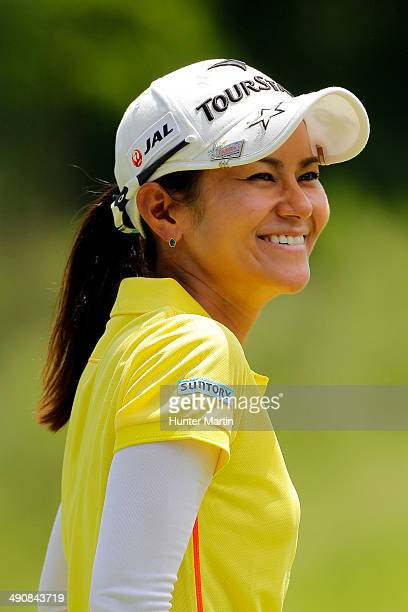 Ai Miyazato of Japan laughs as she stands on the eighth green during the first round of the Kingsmill Championship presented by JTBC on the River...