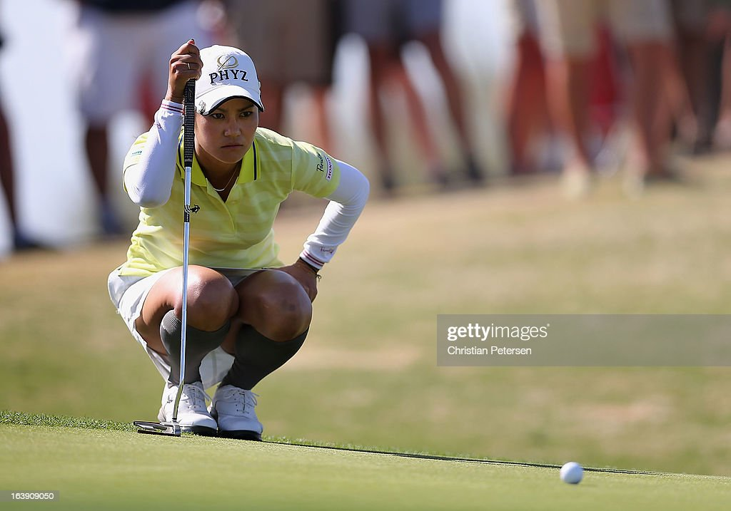 Ai Miyazato of Japan lines up a putt on the 15th hole green during the final round of the RR Donnelley LPGA Founders Cup at Wildfire Golf Club on March 17, 2013 in Phoenix, Arizona.