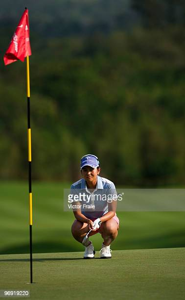Ai Miyazato of Japan lines up a putt on the 18th green during the final round of the Honda PTT LPGA Thailand at Siam Country Club on February 21 2010...