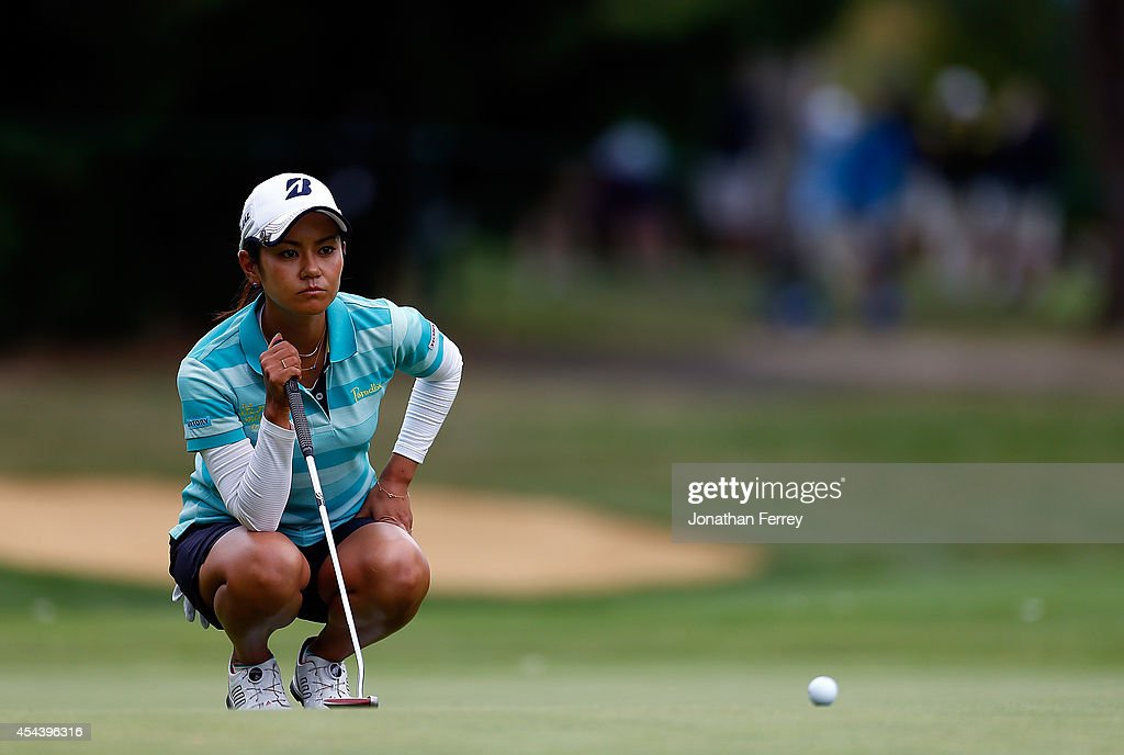 Ai Miyazato of Japan lines up a putt on the 2nd hole during the third round of the LPGA Portland Classic at the Columbia Edgewater Country Club on August 30, 2014 in Portland, Oregon.