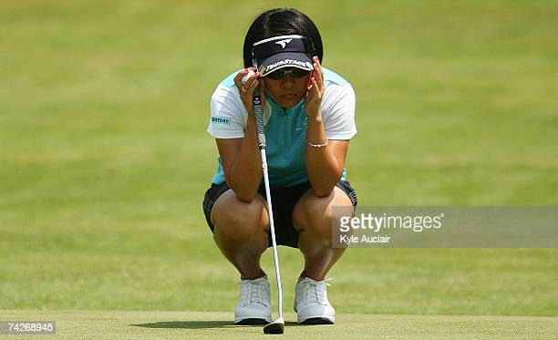 Ai Miyazato of Japan lines up a putt on the eighth hole during the first round of the Corning Classic at the Corning Country Club on May 24 2007 in...