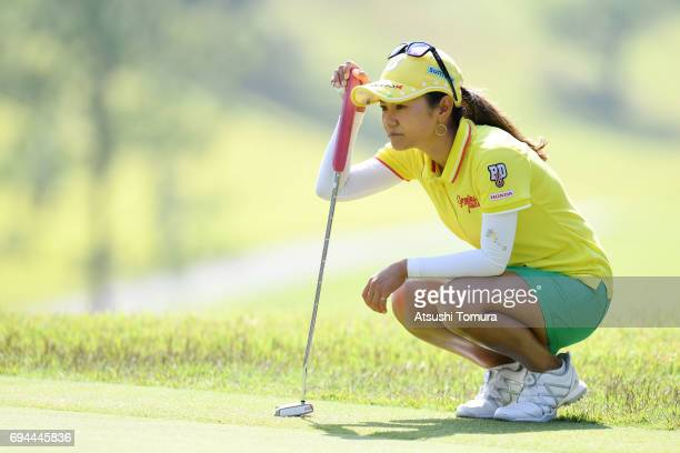 Ai Miyazato of Japan lines up her putt on the 2nd hole during the third round of the Suntory Ladies Open at the Rokko Kokusai Golf Club on June 10...
