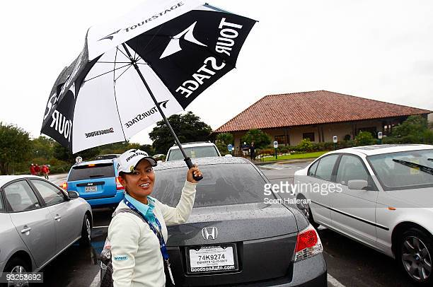 Ai Miyazato of Japan loads her golf clubs into her car after play was suspended during the second round of the LPGA Tour Championship presented by...