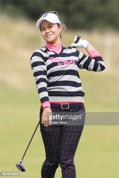 Ai Miyazato of Japan looks at the ball after hitting her third shot on the third hole during the final round of the Ladies Scottish Open at Dundonald...
