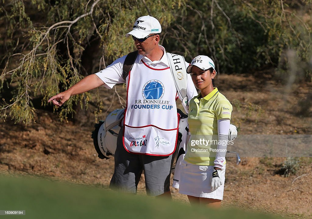 Ai Miyazato of Japan looks up to the16th hole green from the desert area with her caddie during the final round of the RR Donnelley LPGA Founders Cup at Wildfire Golf Club on March 17, 2013 in Phoenix, Arizona.