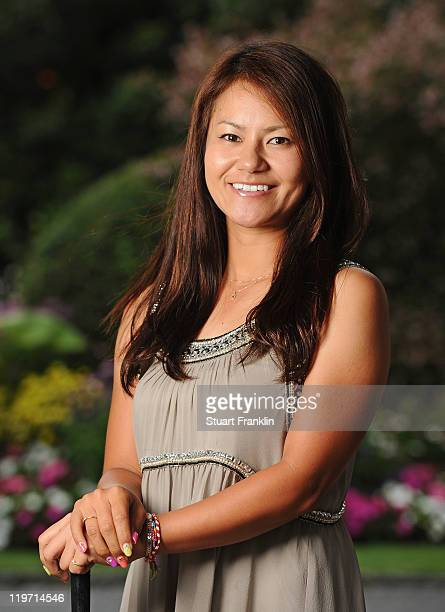Ai Miyazato of Japan poses for a picture at the gala dinner after the third round of the Evian Masters at the Evian Masters golf club on July 23 2011...