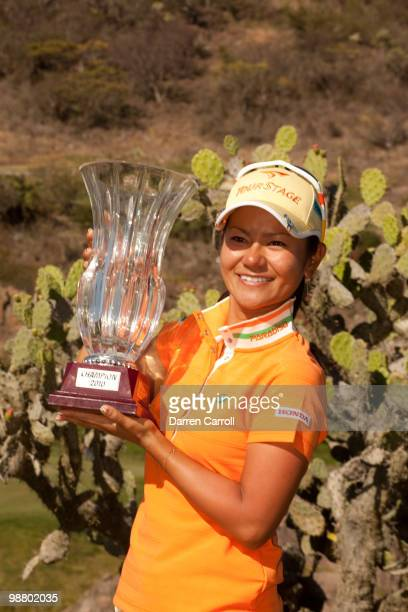 Ai Miyazato of Japan poses with the champion's trophy following the fourth round of the Tres Marias Championship at the Tres Marias Country Club on...