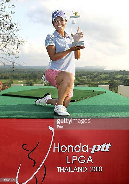 Ai Miyazato of Japan poses with the trophy after winning the final round of the Honda PTT LPGA Thailand at Siam Country Club on February 21 2010 in...