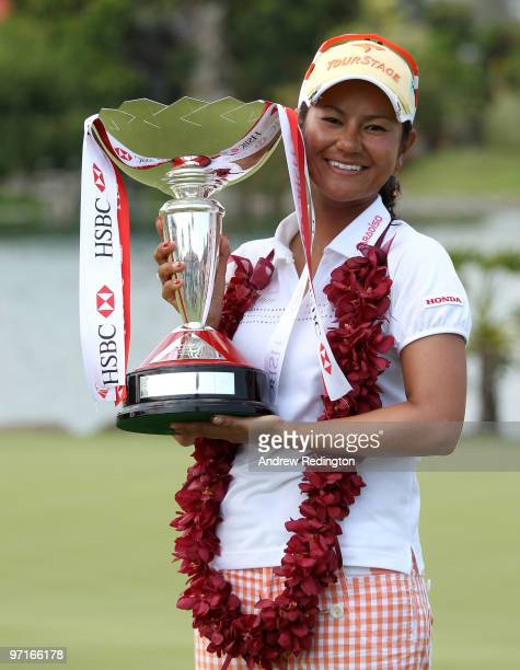 Ai Miyazato of Japan poses with the trophy after winning the HSBC Women's Champions at the Tanah Merah Country Club on February 28 2010 in Singapore