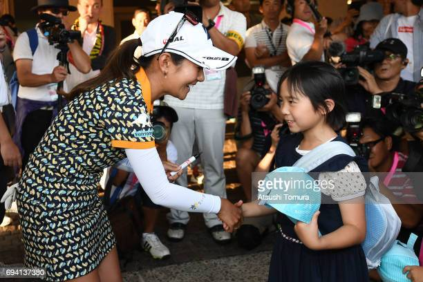 Ai Miyazato of Japan signs an autograph during the second round of the Suntory Ladies Open at the Rokko Kokusai Golf Club on June 9 2017 in Kobe Japan