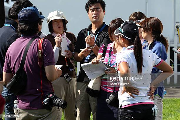 Ai Miyazato of Japan speaks with the media during a practice round prior to the start of the LPGA Championship presented by Wegman's 2010 at the...