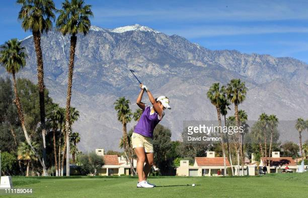 Ai Miyazato of Japan swings during the proam for the 2011 Kraft Nabisco Championship on the Dinah Shore Championship Course at the Mission Hills...