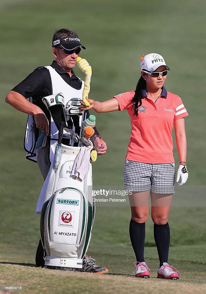 Ai Miyazato of Japan takes a club from her bag on the 18th hole during the third round of the RR Donnelley LPGA Founders Cup at Wildfire Golf Club on March 16, 2013 in Phoenix, Arizona.