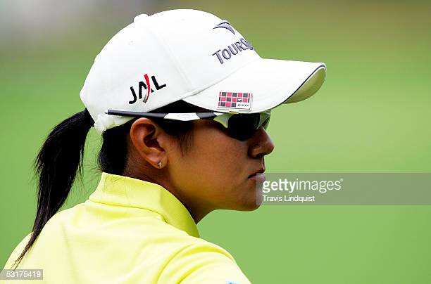 Ai Miyazato of Japan waits on the 10th hole for her opponent Laura Diaz to hit out of the rough during the first round of the HSBC Women's World...