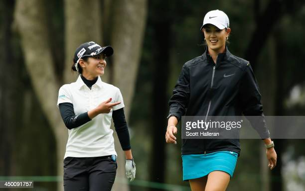 Ai Miyazato of Japan walks off the 14th tee with Michelle Wie of the USA during the third round of the Lorena Ochoa Invitational Presented by Banamex...