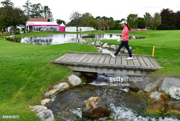 Ai Miyazato of Japan walks over the bridge on the 18th hole during her last competative round of golf during the final round of The Evian...