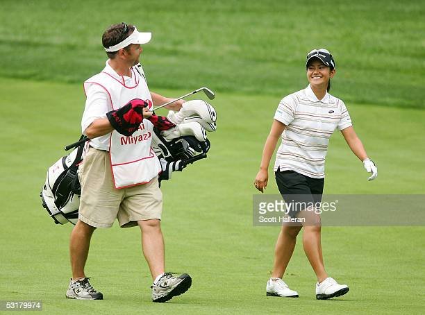 Ai Miyazato of Japan walks with her caddie to the second green during her match with Juli Inkster during the second round of the HSBC World Match...
