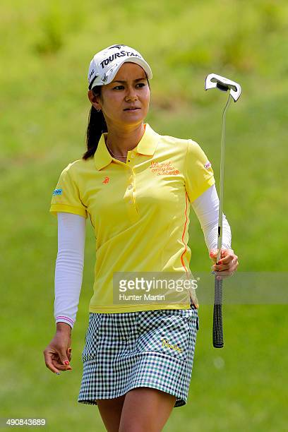 Ai Miyazato of Japan watches her putt on the eighth green during the first round of the Kingsmill Championship presented by JTBC on the River Course...