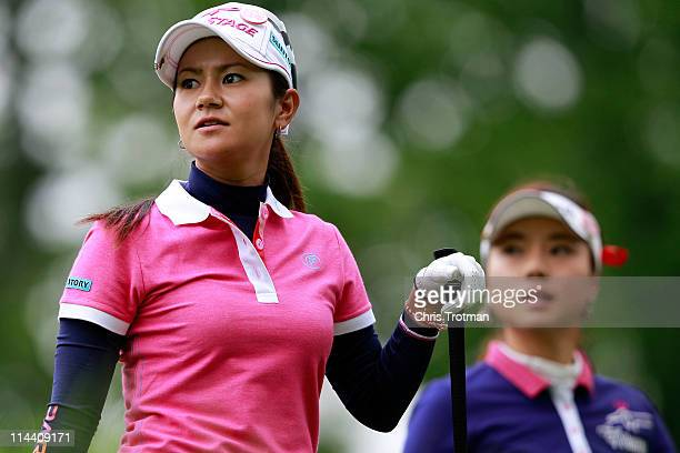 Ai Miyazato of Japan watches her tee shot on the third hole during her match against Hee Young Park of South Korea during round one of the Sybase...