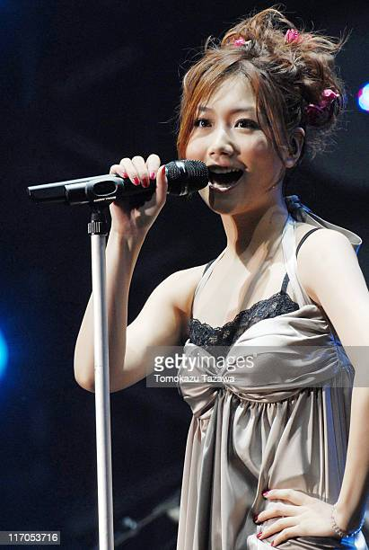 Ai Otsuka performs on stage at the Tokyo leg of the Live Earth series of concerts at Makuhari Messe Chiba on July 7 2007 in Tokyo Japan