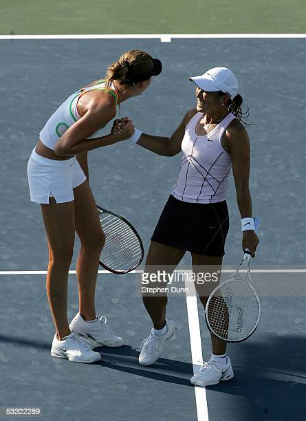 Ai Sugiyama of Japan and Daniela Hantuchova of Slovakia celebrate their win against Nathalie Dechy of France and Francesca Schiavone of Italy during...