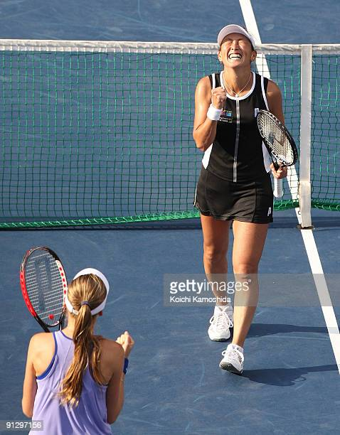 Ai Sugiyama of Japan and Daniela Hantuchova of Slovakia celebrate after their women's doubles quarterfinal match against Anabel Medina Garrigues of...