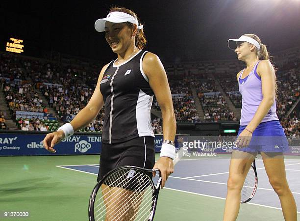 Ai Sugiyama of Japan and Daniela Hantuchova of Slovakia walk from the court in their doubles final match against Francesca Schiavone of Italy and...