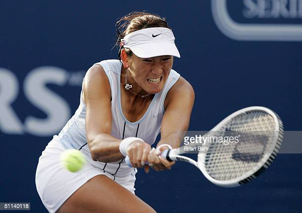 Ai Sugiyama of Japan double arms a backhand against Daniela Hantuchova of Slovakia during the second round of the Rogers Cup on August 3 2004 at...