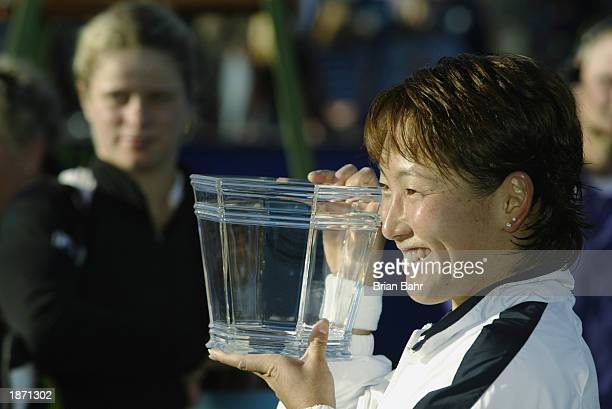 Ai Sugiyama of Japan holds up the winner's trophy after defeating Kim Clijsters of Belgium 36 75 64 during the finals of the State Farm Women's...