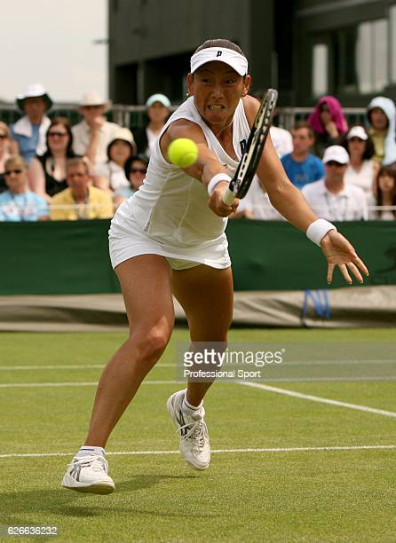 Ai Sugiyama of Japan in action during the women's singles round two match against Yanina Wickmayer of Belgium on day two of the Wimbledon Lawn Tennis...