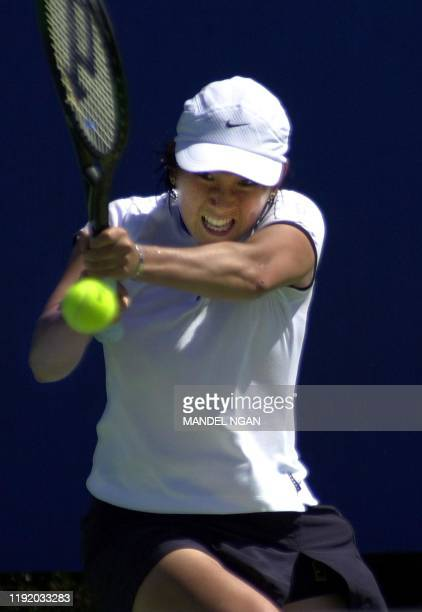 Ai Sugiyama of Japan makes a return to Magdalena Maleeva of Bulgaria 17 January 2000 in the first round of the Australian Open in Melbourne Sugiyama...