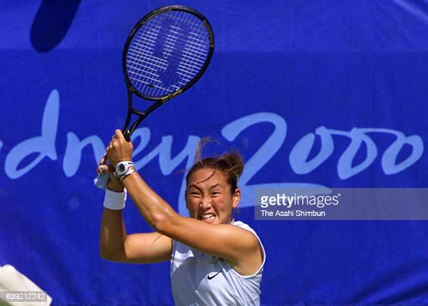 Ai Sugiyama of Japan plays a backhand during the Tennis Women's Singles first round match against Jelena Dokic of Australia during the Sydney...