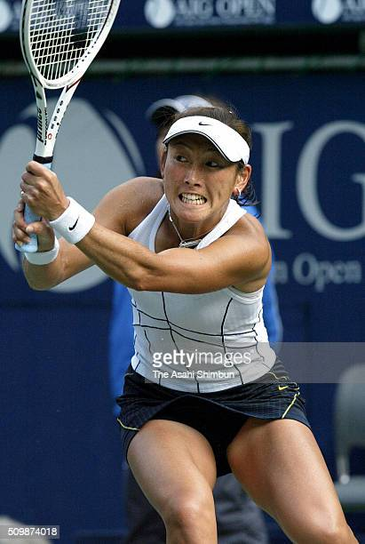 Ai Sugiyama of Japan plays a backhand during the Women's singles quarter final match against Tatiana Golovin of France during day five of the AIG...