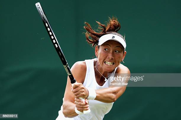 Ai Sugiyama of Japan plays a backhand during the women's singles second round match against Arantxa Parra Santonja of Spain on Day Three of the...
