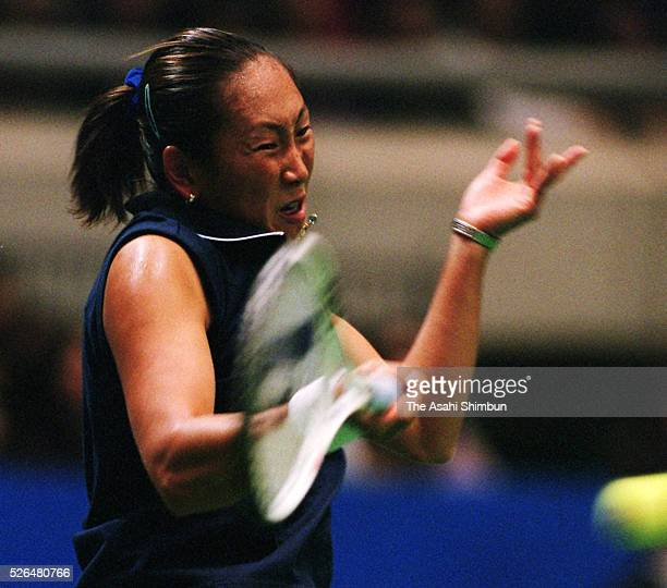 Ai Sugiyama of Japan plays a forehand during her singles quarter final against Martina Hingis of Switzerland during day four of the Toray Pan Pacific...