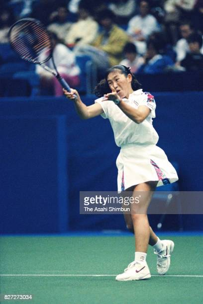 Ai Sugiyama of Japan plays a forekhand during the singles first round against Martina Navratilova of the Czech Republic in the Pan Pacific Open...