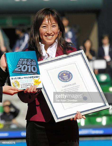 Ai Sugiyama of Japan poses for photographs with the Guinness World Records certificate during the All Japan Tennis Championships at Ariake Colosseum...