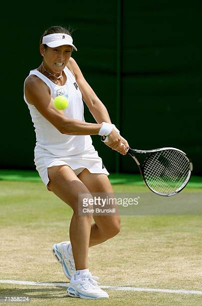 Ai Sugiyama of Japan returns a backhand to Severine Bremond of France during day seven of the Wimbledon Lawn Tennis Championships at the All England...