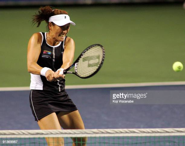 Ai Sugiyama of Japan returns against Francesca Schiavone of Italy and Alisa Kleybanova of Russia in her doubles final match with and Daniela...