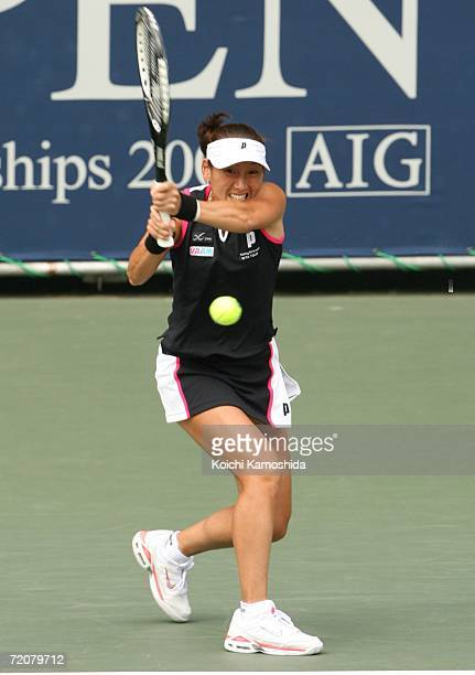 Ai Sugiyama of Japan returns the ball against Emma Laine of Finland during the AIG Japan Open Tennis Championship 2006 on October 4 2006 in Tokyo...