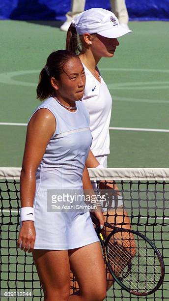 Ai Sugiyama of Japan shows dejection after her defeat by Jelena Dokic of Australia after the Tennis Women's Singles first round match during the...