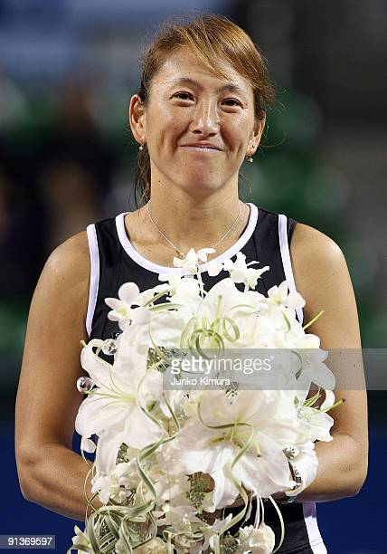 Ai Sugiyama of Japan smiles during a ceremony on day seven of the Toray Pan Pacific Open Tennis tournament at Ariake Colosseum on October 3 2009 in...
